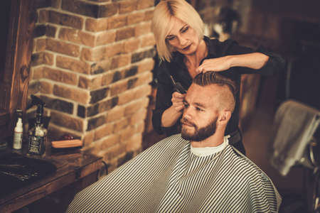 hairstylist: Client visiting hairstylist in barber shop Stock Photo