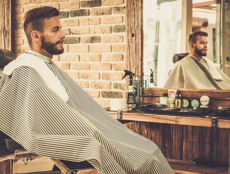barber: Stylish man in a barber shop