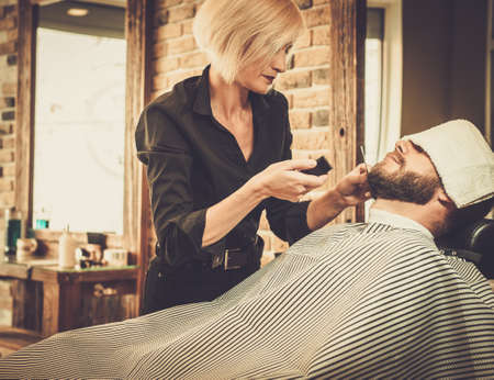 beards: Client during beard and moustache grooming in barber shop