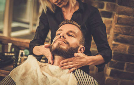beard woman: Hipster client visiting  barber shop