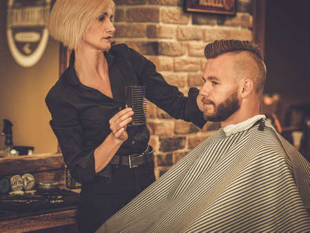 barber chair: Client visiting hairstylist in barber shop Stock Photo