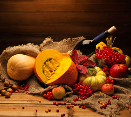 Still: Thanksgiving day autumnal still life with bottle of wine