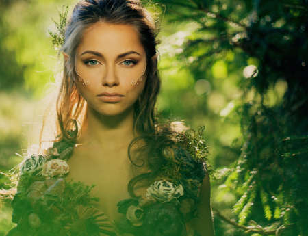 elf: Elf woman in a magical forest Stock Photo