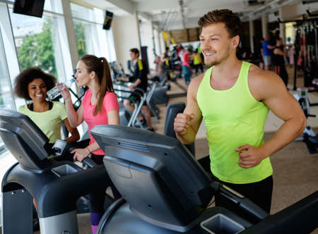 Man running on a treadmill in a gym Stock Photo