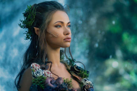 fantasy makeup: Elf woman in a magical forest Stock Photo