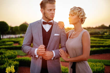 welldressed: Well-dressed couple in a beautiful park Stock Photo