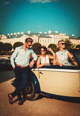 rich people: Wealthy friends in a classic convertible