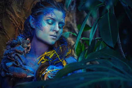fantasy makeup: Avatar woman in a magical forest Stock Photo