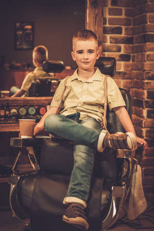barber: Stylish little boy in a barber shop