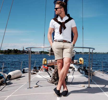 regatta: Stylish trendy man on a regatta