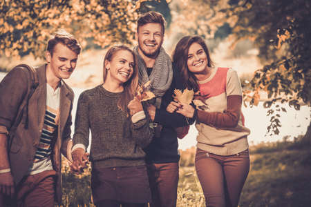 friend hug: Cheerful friends in autumn park Stock Photo
