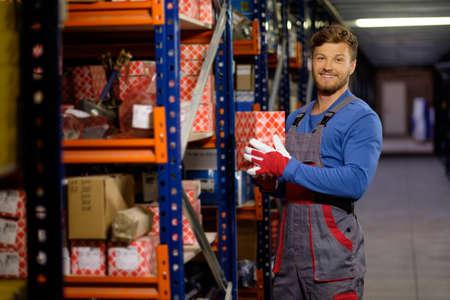 automotive: Worker on a automotive spare parts warehouse