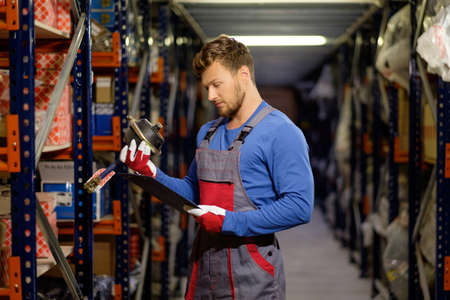storekeeper: Worker on a automotive spare parts warehouse