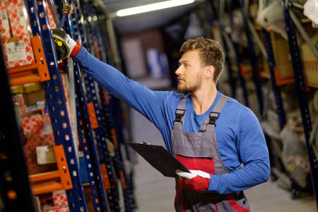 warehouse: Worker on a automotive spare parts warehouse