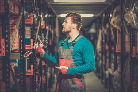stockman: Worker on a automotive spare parts warehouse