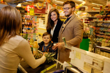budget: Young family in a grocery store Stock Photo