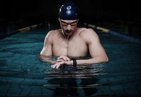 heart rate monitor: Swimmer with heart rate monitor in swimming pool