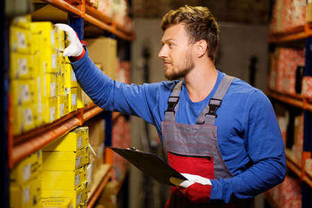 warehouse worker: Worker on a automotive spare parts warehouse