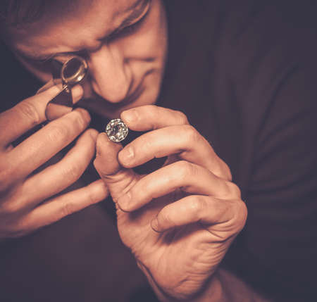 comparisons: Portrait of a jeweler during the evaluation of jewels.