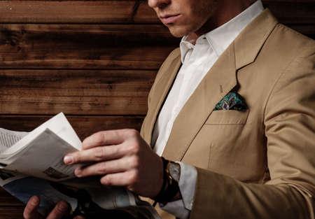 dressed: Stylish man wearing jacket in rural cottage interior
