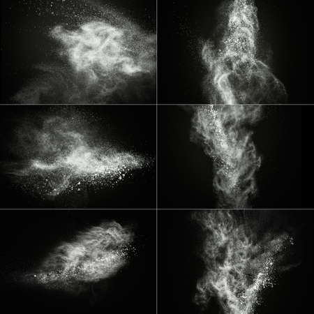 the particles: White powder exploding isolated on black