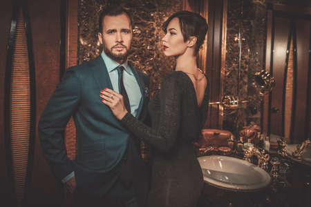 welldressed: Well-dressed couple in luxury bathroom interior.