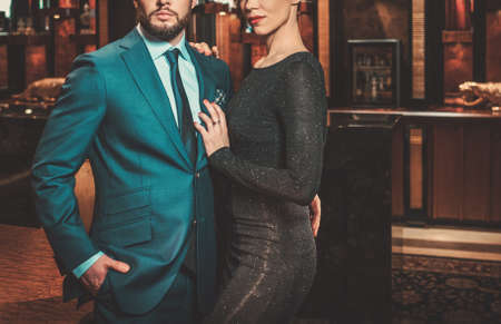 luxury apartment: Well-dressed couple in luxury apartment interior. Stock Photo