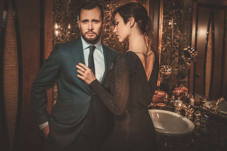 couple bathroom: Well-dressed couple in luxury bathroom interior.