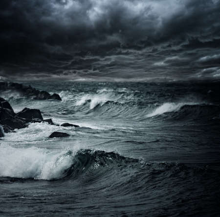 stormy: Dark stormy sky over ocean with big waves Stock Photo