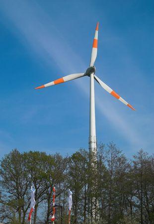 Energy-producing windmill waiting for the strong wind photo