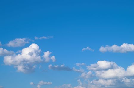 Blue sky with white cumulus clouds at the bottom