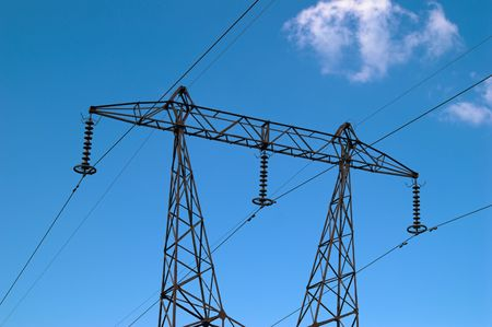 tangent: High-voltage power transmission tower over blue sky
