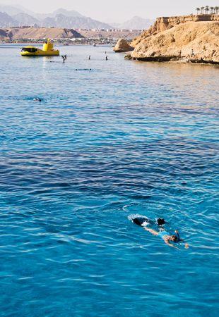 Woman Snorkeling in open blue lagoon, Red Sea, Egypt Stock Photo - 1173079