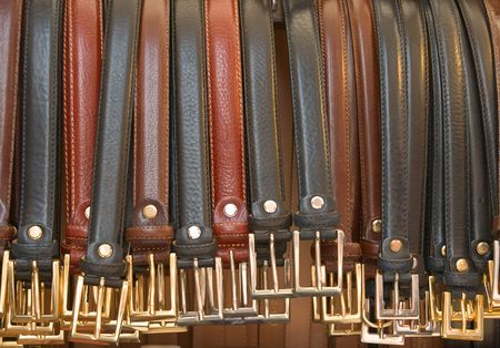 impotence: Gentleman belts hang down in a row for sale. Also good as metaphor of impotence or crowded competition.