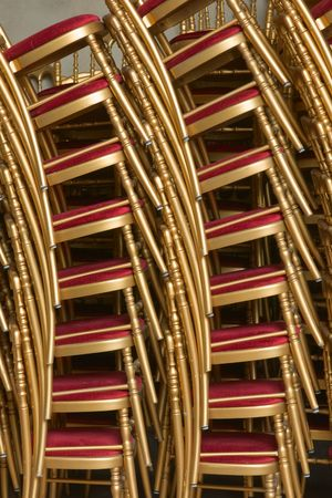 postpone: Stack of chairs vertical