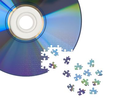writable: CD  DVD cut by jigsaw puzzle. Concept of data manipulation, archiving, security, encryption or decryption.