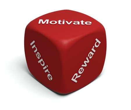 motivate: Red Dice with words Inspire, Motivate, Reward on faces