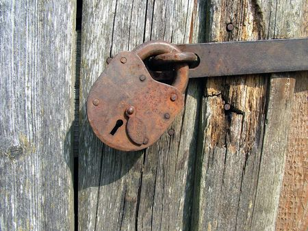 Old lock made by hand and rotten wall