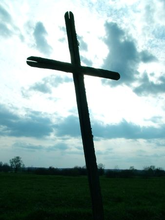 Old Cross in field Stock Photo