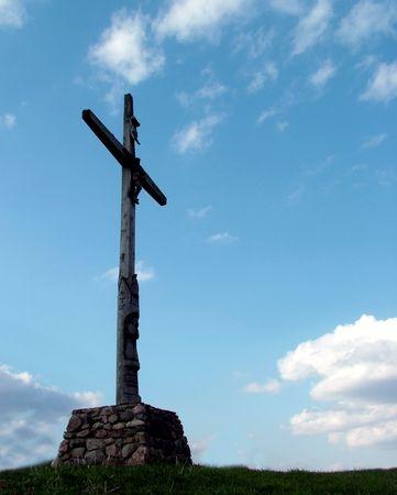 Cross statue in sky Stock Photo