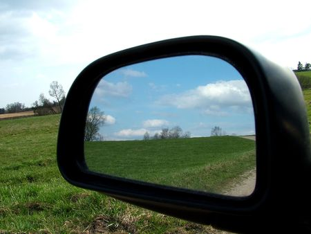 Rear view on a car mirror, road to hill 1 photo