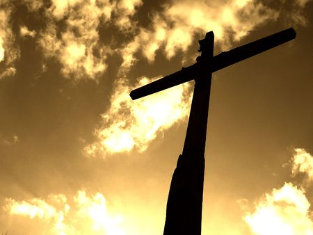 Cross in sky, sepia mode Stock Photo