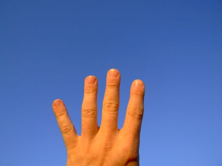 Hand series : 4, against clear blue sky photo
