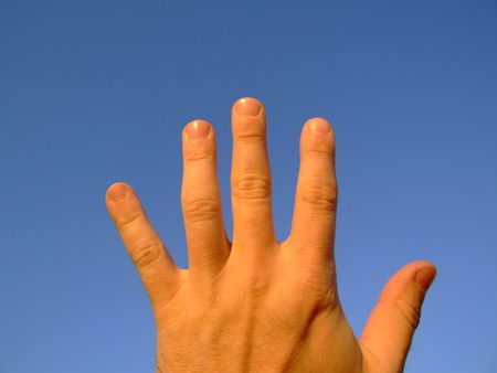 Hand series : 5, against clear blue sky photo