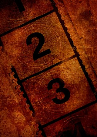 Film overlayed on a grunge effect background in orange Stock Photo