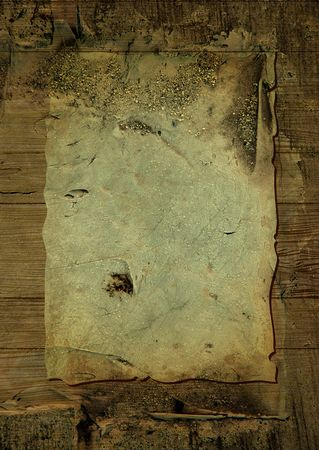Worn parchment placed over a wooden background with crustyness Stock Photo