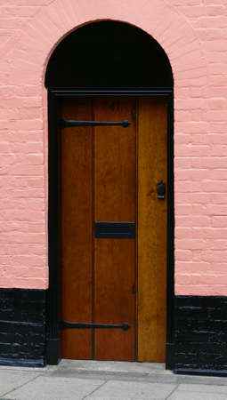 building feature: feature door in a pink building Stock Photo