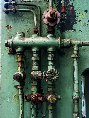 waterpipe: Old rusty pipes and valves with water leaks