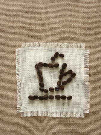 coffee sack: Drawing of coffee cup by coffee seed on the sackcloth