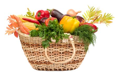 vegetable basket: lots of fresh and ripe vegetables in the basket on white background